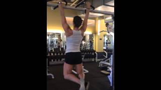 Girl Performing 20 dead hang pull-ups again.