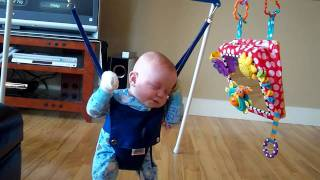 baby falls asleep in jolly jumper