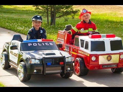 Power Wheels Race - Policeman (Sidewalk Cop) vs Fireman!
