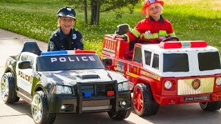 Power Wheels Race - Policeman (Sidewalk Cop) vs Fireman!