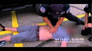 CAUGHT ON CAMERA: Police administer lifesaving CPR, shot after man collapses