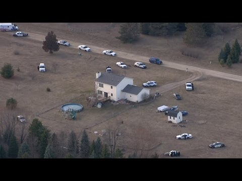 Police surround house in Hamburg Township