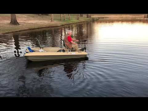 Uncle Muriel trying out a Pelican bass boat