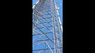 Me climbing a 250 ft tower