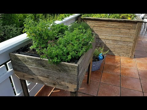 DIY planter box for herbs made of reclaimed wood.
