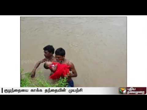 Father carries sick child in flood to hospital in Andhra Pradesh