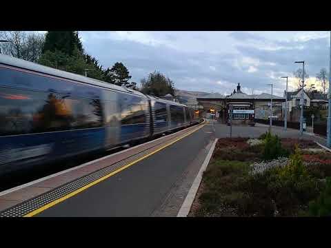 Evening passenger train passes through Gleneagles