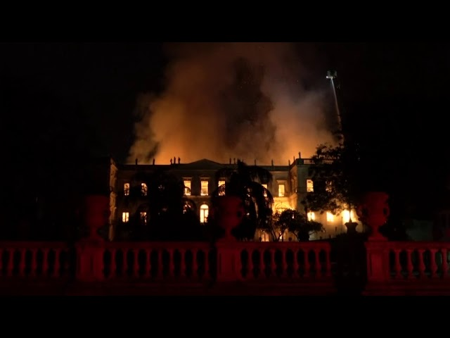Fire crews try to save relics from Rio museum fire
