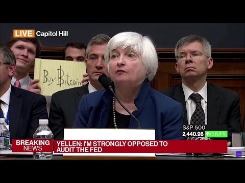 """Buy Bitcoin"" sign behind Yellen"