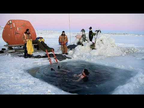 Antarctic researchers take icy plunge to celebrate solstice