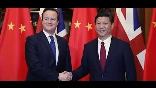 Chinese President Xi Jinping meets with British Prime Minister David Cameron