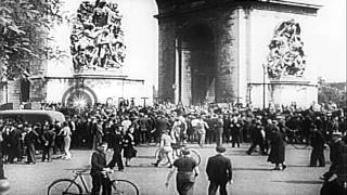 German Tank Panzer Division parades on streets of Paris in France. HD Stock Footage(Link to order this clip: http://www.criticalpast.com/video/65675043356_German-Tank-Panzer-Division_soldiers-parade_Eiffel-Tower_Arch-of-Triumph Historic ..., 2014-05-05T08:44:24.000Z)