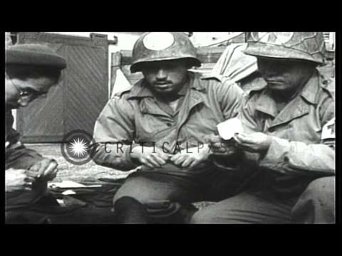 Medics of 3rd Medical Battalion, treat a wounded soldier of 442nd Regimental Comb...HD Stock Footage