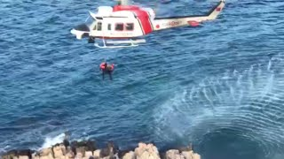 People stranded on rocks rescued by Turkish coastguards
