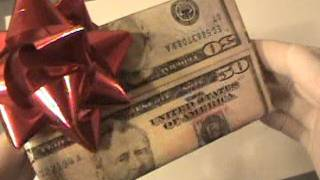 Wrapping a Christmas gift with Real 50 dollar bills
