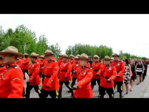 Thousands attend RCMP regimental funeral service for Moncton officers- Canada