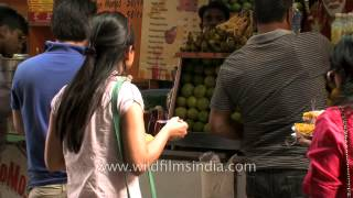People Enjoying A Spicy Treat : Bhel Puri