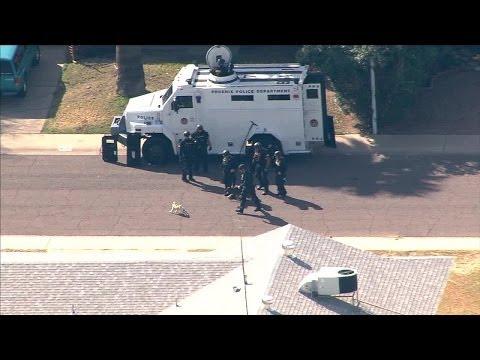 Pug picks fight with police dog outside Phoenix barricade