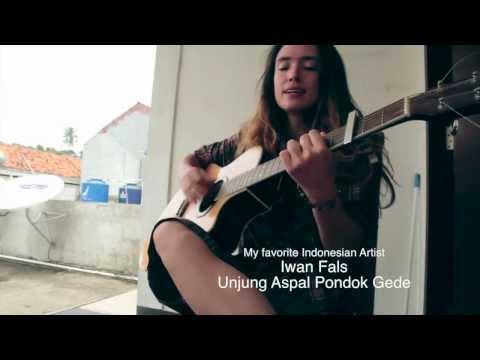 singing Iwan Fals song - Ujung Aspal Pondok Gede