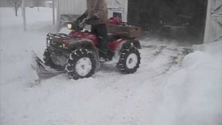 Repeat youtube video Honda Foreman 450 Plowing Snow