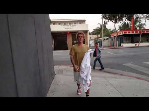 Justin Bieber makes fun of paparazzi in Los Angeles, Ca