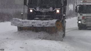 Snow plows clearing the highway in Norway