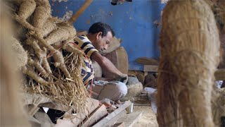 Shot of a man making face of Durga idol with clay mud in his workshop