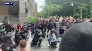 Portland Police kneel with peaceful protesters