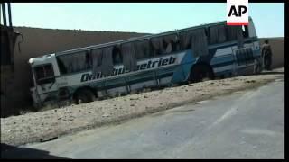 Police say bomber targeting NATO convoy hits bus; kills child, injures 28
