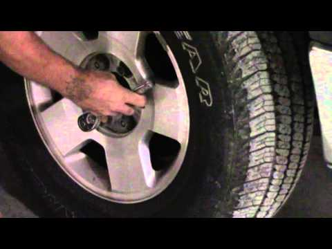Using a socket to loosen lug nuts tightened by an impact wrench