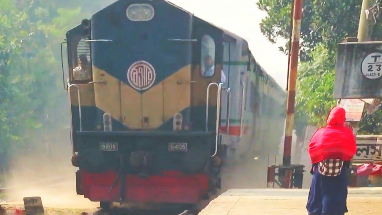 white metal snake Rupsha Express with Diesel locomotive passing Through halsha railway station