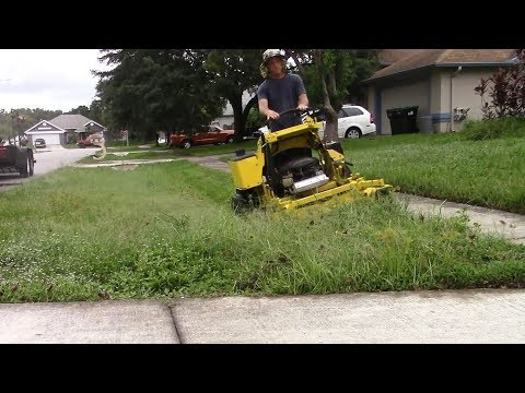 Lawn care vlog #47 Very wet yard clean up - Tall, thick, wet grass mowing
