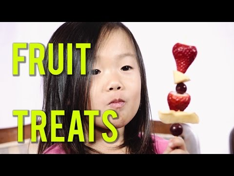 Healthy Eating For Kids With Fruit Snack Treats Apples Grapes Strawberries On a Popsicle Stick