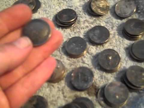 Quarters from burned house: Metal Detected cache of heat damaged coins.