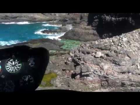 Low level Helicopter flight around south and east coast of Oahu