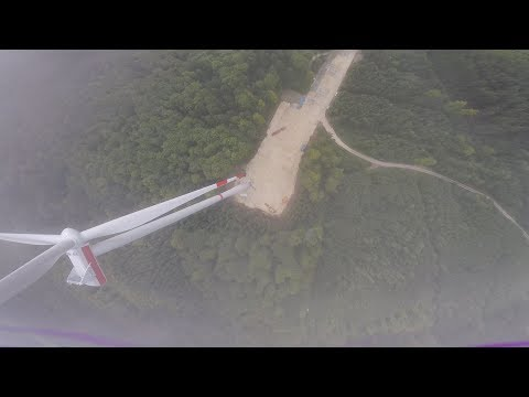 FPV to the top of a huge WIND TURBINE in the Clouds