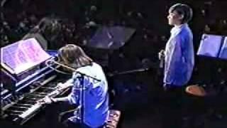"TK & KCO (Keiko) performing ""悲しいね"" in 1998."