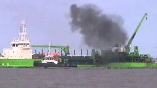 Ship catches fire just off shore MUST SEE