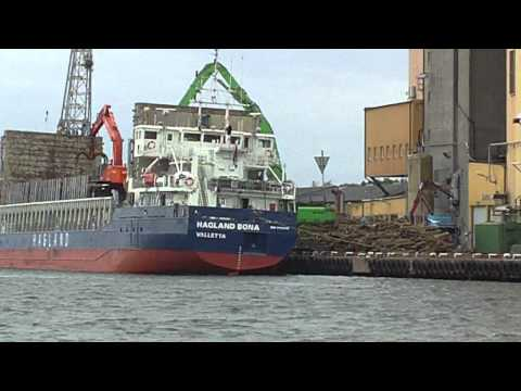 "SHIP ""HAGLAND BONA""with Timber offloading in harbor"