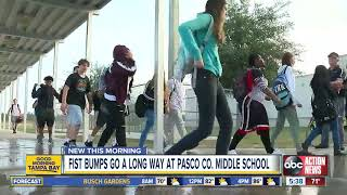 Two Pasco Co. school employees help kids get their day started on a positive note with a fist bump