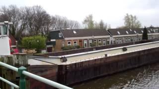 Cargo ship + open bridge + old houses , Rotterdam , Overschie