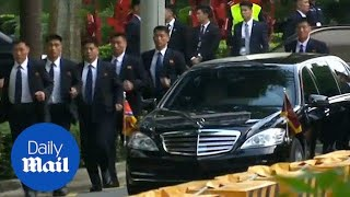 North Korean leader Kim Jong Un's security run alongside motorcade