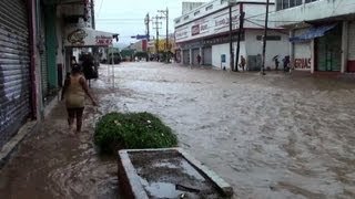 Deadly hurricane, tropical storm combine in Mexico