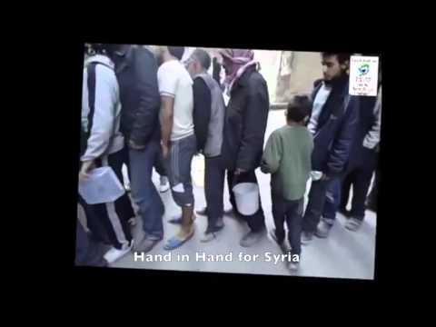 Distribution of food aid inside Yarmouk refugee camp in Damascus