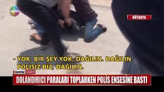 Dolandırıcı paraları toplarken polis ensesine bastı