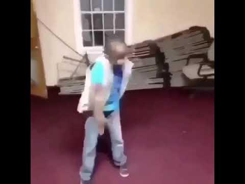 Black kid dancing to Spanish music