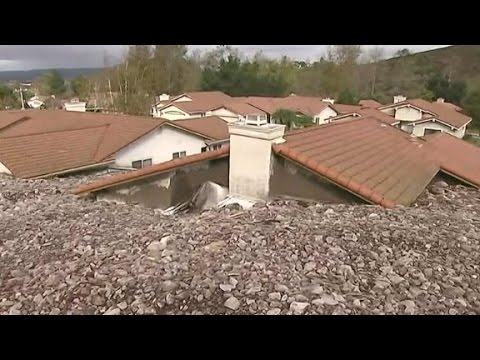 Homes buried by tons of rocks and mud