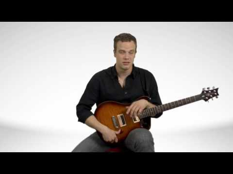 How To Hold An Electric Guitar - Guitar Lessons