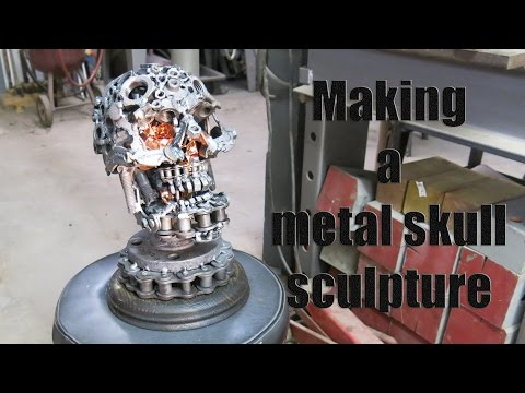 The making of a metal skull sculpture.