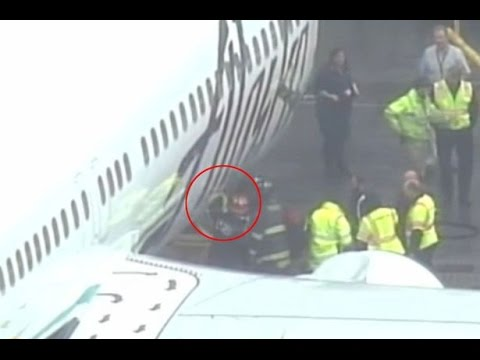 Alaska Airlines makes emergency landing in Seattle after worker trapped in cargo